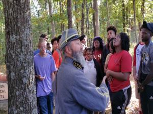 Civil War Class 2016 Field trip to Parkers Crossroads.  Students listening to the story of the Union soldier still buried on the battlefield, while some students watch a squirrel we had disturbed