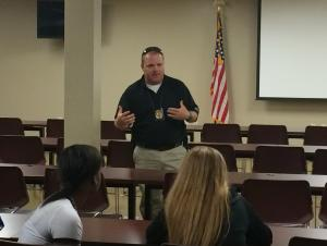 Detective Dennis speaking to the class at DPS headquarters