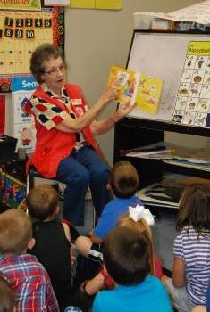 Granny Rose reads to students in Ms. Carma's class