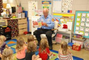 Mr. Ronnie reads to students in PK about fire saftey.