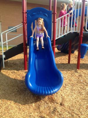 Children enjoy the new playground equipment
