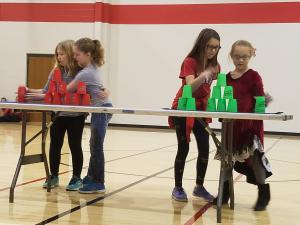 Mackenzie and Kiara vs Hattie and Kayleigh in partner stacking.