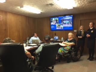 Chapter President Faith Wheeler and Chapter Vice President Breeanna Hicks give board presentation