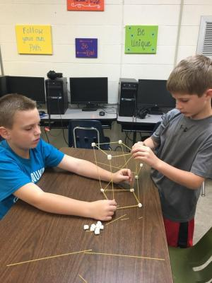 Kaiden and Kaleb working hard on their marshmallow tower!
