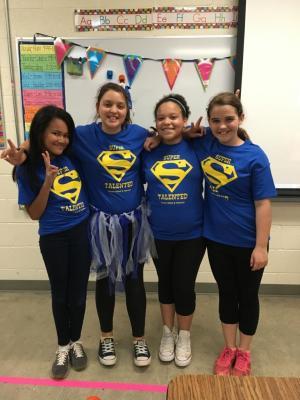 6th grade GT girls modeling their new GT shirts!  Congratulations to Brooke Smedley, class logo design winner!