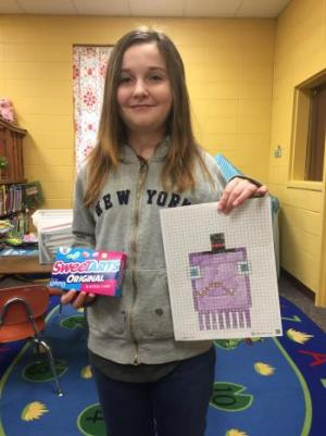 Skylar and her award-winning pixel squid!