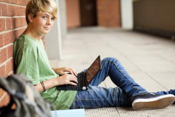Boy sitting with laptop