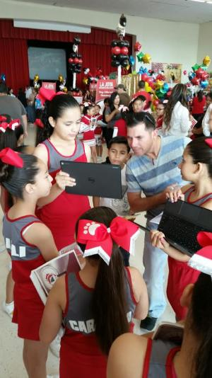 Showing parents our school website at the Why La Joya Event.