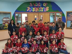 Football Players and Cheerleaders with their sponsors, Coach Chapa and Mrs. R. Sandoval.