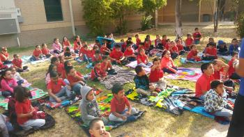 Kinder students having a reading picnic