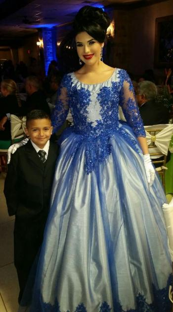 Jonas Martinez, 2nd grader at Perez Elementary, with the Duchess of Whitewing, student at Palmview High School, at the Citrus Fiesta Royal Reception.
