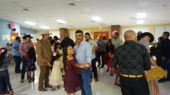 Perez Elementary Fathers and Daughters dancing at the Cowboys and Angels Father-Daughter Dance.