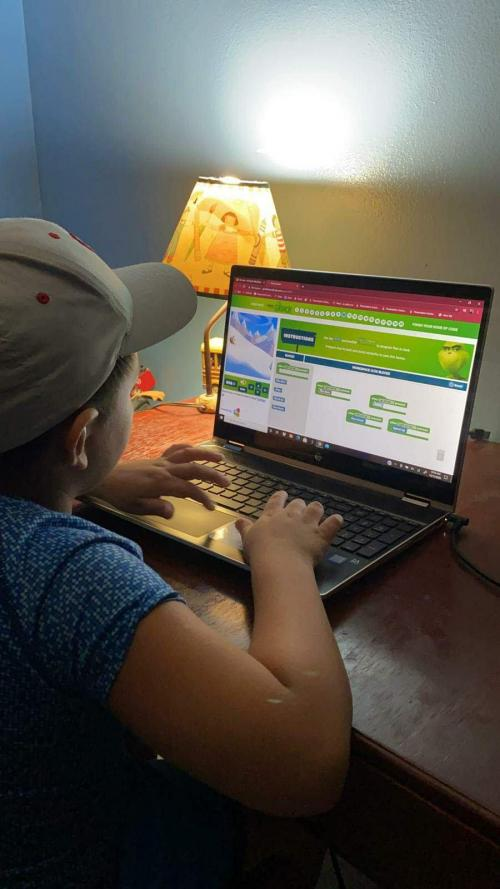 student using hour of code on computer