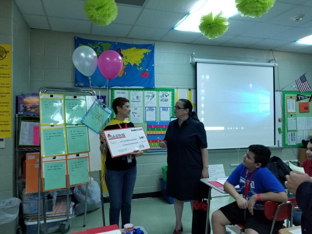 ms. oliver receives recognition through a grant