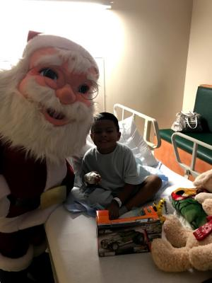 Student dressed up as Santa and entertained kids at the Hospital