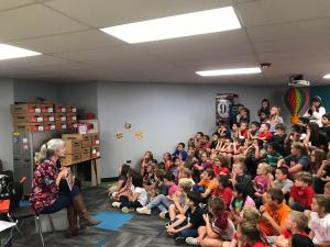 Students listening to a visiting author and illustrator  2017-2018 School Year