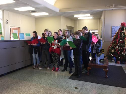 Junior Choir members caroling on the square.