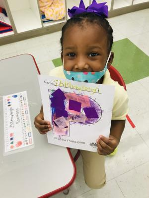 We learned about the letter P. We glued pink and purple paper on it.