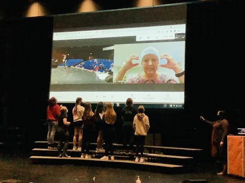 Mrs. Rhoadarmer instructs middle school choir