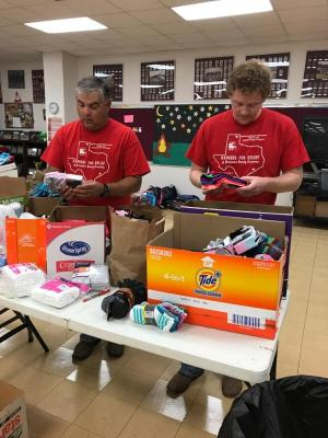 Mr. Cates & Mr. Birdwell preparing donations