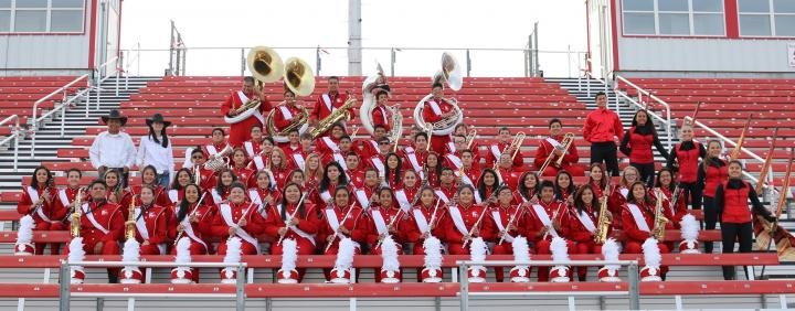 Photo of Perryton High School band in uniform posing for group picture.