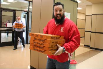 Mr. Garcia bringing the pizza!