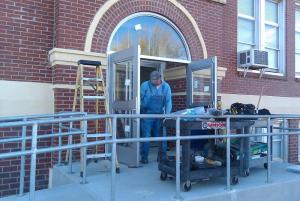 Added 11-17-2011: Installation of new front doors.