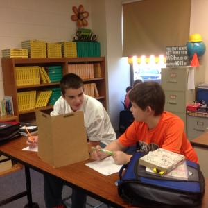 two boys collaborating