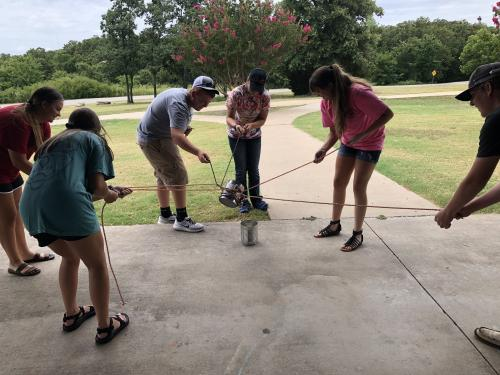 FFA officers learning how to work together, transporting water in a team building challenge