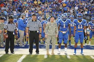 Foot Hood Soldier on the sidelines with CCHS Football Captains awaiting coin toss.