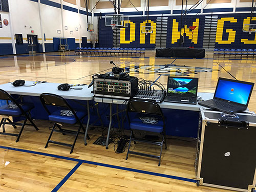 Bulldawg Radio Gymnasium Production Desk showing rack mounted PreAmps & Compressor, Mackie 12 channel Mixer, 2 Dell Laptops