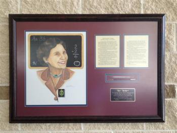 Framed Meorial to Mrs. Lea Ledger in the foyer of the auditorium.