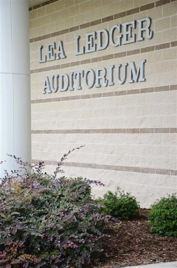 Exterio of Lea Ledger Auditorium showing building signage