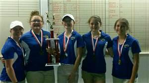 The CCJHS golf team poses with a trophy