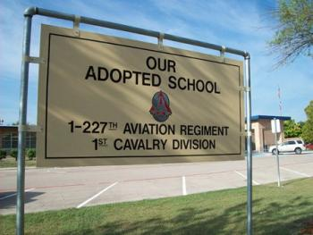 Sign at CCJHS which readsOur Adopted School. 1-227th Aviation Regiment. 1st Cavalry Division