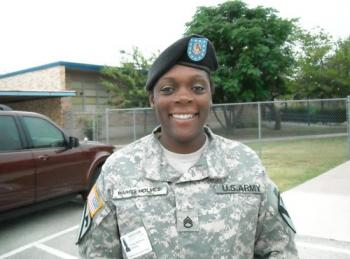 A female solder from our adopted unit smiles for the camera in the CCJHS Parking Lot.