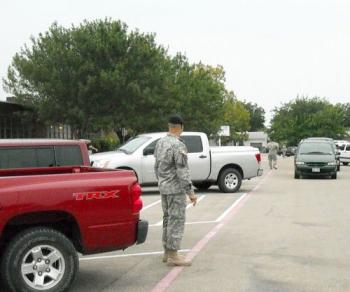 Our Adopted Soldiers greet students in the parent drop off area of the parking lot.