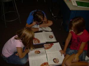 Trevor, Alison, and Trinity reading