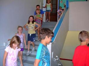 Walking down the stairs... we are going to miss those!  LOL