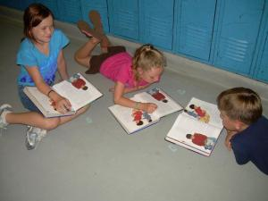 Lilly, Baylee, and Nathan reading