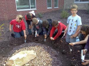 We planted Red Tulips right outside the Purple Pod and Mrs. Hedricks office!