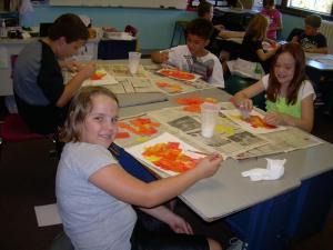 Jaxcen showing her pumpkin art.