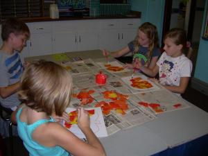 Russ, Alison, Baylee, and Olivia working on their pumpkin art.