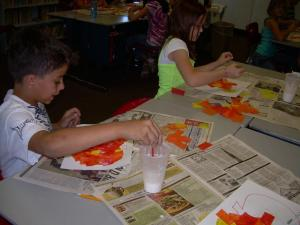 Nicholas and Lilly working on their pumpkin art.