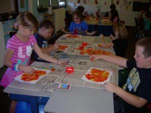 McKenzie, Nathan, Trevor, Trinity and Dusty working on their pumpkin art.