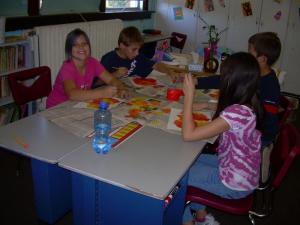 Brooke, Chris, Joseph and Micci working hard on their pumpkin art.