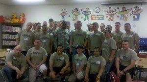 A group of our adopted soldier poses in a classroom.