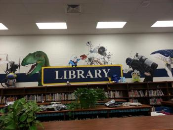 Picture of interior of library including the large wall mural