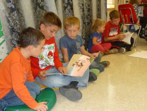 Older students read to Kindergarten students