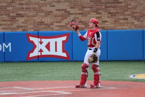 My son, Brady, catching at a KU baseball showcase.
